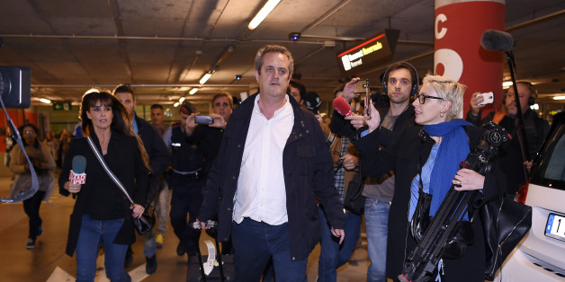 Catalan dismissed Interior chief Joaquim Forn (C) is followed by journalists upon his arrival at El Prat airport in Barcelona after flying from Brussel on October 31, 2017.Spain's top criminal court today summoned Catalonia's axed separatist leader for questioning, hours after he appeared in Brussels insisting he remained the 'legitimate president' of a region now under direct rule from Madrid. The National Audience in Madrid, which deals with major criminal cases, summoned Carles Puigdemont and