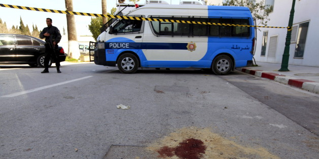 A policeman stands past blood stains, inside the compound of the national Bardo museum in Tunis March 19, 2015. Tunisia said it would deploy the army to major cities and arrested four people on Thursday after militant gunmen killed 20 foreign tourists visiting the national Bardo museum, the worst attack on the north African country in more than a decade.   REUTERS/Anis Mili
