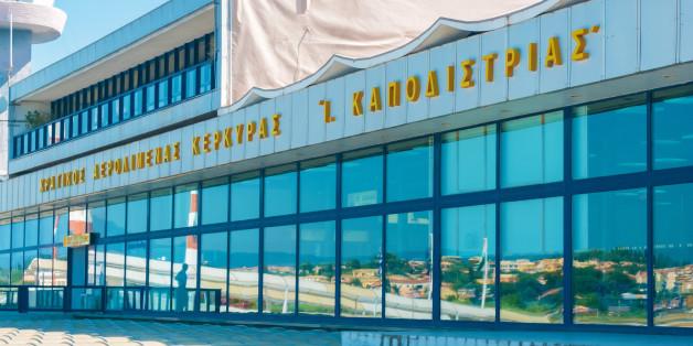 CORFU, GREECE - JUNE 30, 2011: Modern building of Kerkyra airport and tourists