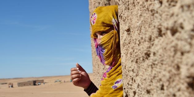Sahrawi refugee Selembouha Dadi stands at her house at the Boujdour camp for Sahrawi refugees on the outskirts of Tindouf, south west of Algeria, on October 20, 2017. / AFP PHOTO / RYAD KRAMDI        (Photo credit should read RYAD KRAMDI/AFP/Getty Images)