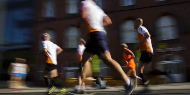Berlin, Germany - August 23: Amateur athletes jog during a city run across a street on August 23, 2015 in Berlin, Germany. (Photo by Thomas Trutschel/Photothek via Getty Images)