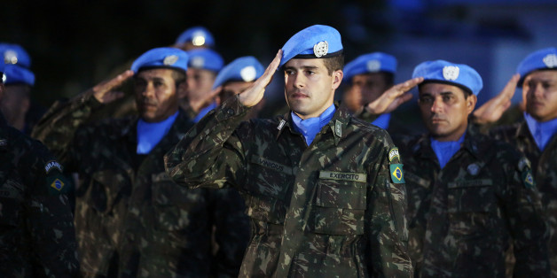 Brazilian U.N. peacekeepers salute during an event marking an end of the Mission of United Nations for the Stabilization in Haiti (MINUSTAH), at the U.N. headquarters in Port-au-Prince, Haiti October 5, 2017. REUTERS/Jeanty Junior Augustin