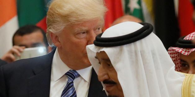 U.S. President Donald Trump and Saudi Arabia's King Salman bin Abdulaziz Al Saud (R) attend the Arab Islamic American Summit in Riyadh, Saudi Arabia May 21, 2017. REUTERS/Jonathan Ernst