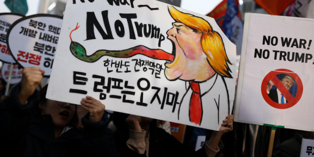 Demonstrators hold placards during a protest ahead of U.S. President Donald Trump's visit near the U.S. Embassy in Seoul, South Korea, on Saturday, Nov. 4, 2017. Trump said Friday that he will add a day to the end of his five-nation tour of Asia, saying he would now stay for 'the most important day' of a regional summit. Photographer: SeongJoon Cho/Bloomberg via Getty Images
