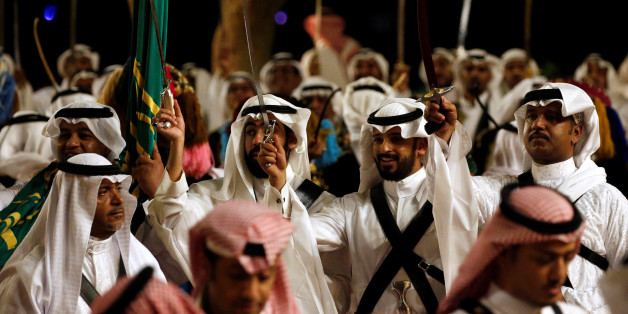 Men hold their swords aloft during a welcoming ceremony for U.S. President Donald Trump and first lady Melania Trump at Al Murabba Palace in Riyadh, Saudi Arabia May 20, 2017. REUTERS/Jonathan Ernst