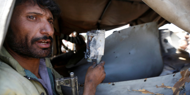 A Houthi fighter holds a part of a drone aircraft which the Houthi rebels said they have downed in Sanaa, Yemen October 1, 2017. REUTERS/Khaled Abdullah