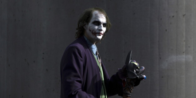 "A man dressed as The Joker from ""Batman"" walks around the exterior on day two of New York Comic Con in Manhattan, New York, October 9, 2015.  The event draws thousands of costumed fans, panels of pop culture luminaries and features a sprawling floor of vendors in a space equivalent to more than three football fields at the Jacob Javits Convention Center on Manhattan's West side. REUTERS/Andrew Kelly"