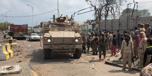 Yemeni men and security forces inspect the site of a suicide bombing in the southern port city of Aden, on November 5, 2017.Al-Qaeda suspects carried out twin suicide bombings and took hostages, officials said, as they struck at the heart of the Yemeni government after suffering a string of setbacks. The apparently coordinated attacks spell an abrupt end to a period of relative calm that has reigned in Aden, where the government of President Abedrabbo Mansour Hadi has been based since it was dri