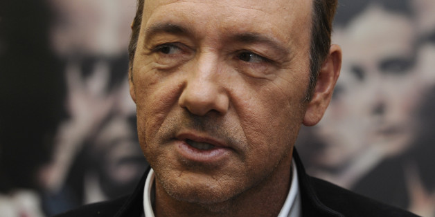 "U.S. actor Kevin Spacey poses during a media event to promote his latest movie ""Margin Call"" in the auditorium of the newly opened Niemeyer Centre, a cultural complex designed by Brazilian architect Oscar Niemeyer, in Aviles, northern Spain September 26, 2011. REUTERS/Eloy Alonso (SPAIN - Tags: ENTERTAINMENT)"