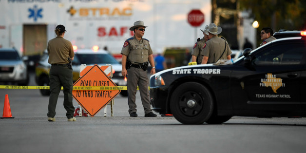 Law enforcement officials set up along a street near the First Baptist Church after a mass shooting in Sutherland Springs, Texas, US., November 5, 2017.  REUTERS/Mohammad Khursheed