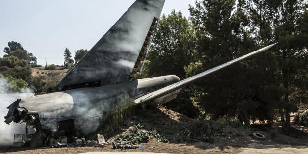 an airplane tail in a plane crash site