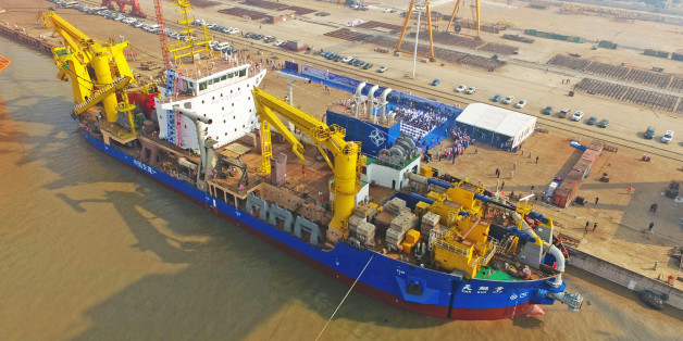 This photo taken on November 3, 2017 shows the ship 'Tian Kun Hao' being launched at a port in Qidong in China's eastern Jiangsu province. China has unveiled a massive ship described as a 'magic island maker' that is Asia's largest dredging vessel, state media reported on November 4. / AFP PHOTO / STR / China OUT        (Photo credit should read STR/AFP/Getty Images)