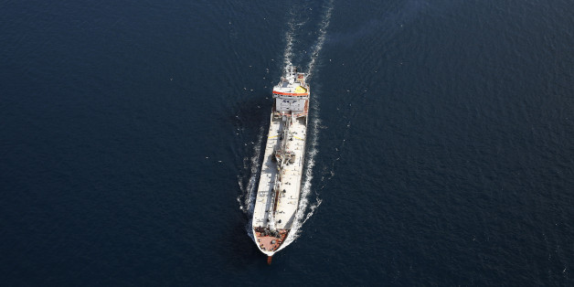 A tanker operated by SCF Group sails from port in the Aegean sea off the coast of Athens, Greece, on Thursday, June 25, 2015. Greece could tap euro-area funds of as much as 3.35 billion euros ($3.75 billion) by early July if it can reach a deal with its creditors, thanks to profit-sharing pledges from member nations' central banks. Photographer: Simon Dawson/Bloomberg via Getty Images