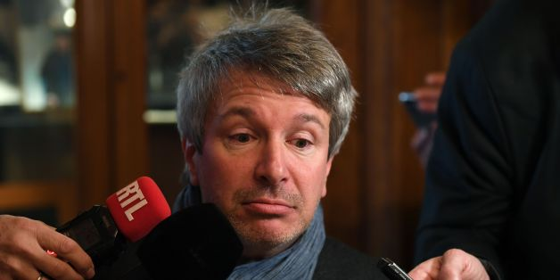 French writer Eric Vuillard reacts as he speaks to journalists after being awarded with the Prix Goncourt for 'L'Ordre du Jour' on November 6, 2017 at the restaurant Drouant in Paris.  / AFP PHOTO / Eric FEFERBERG        (Photo credit should read ERIC FEFERBERG/AFP/Getty Images)
