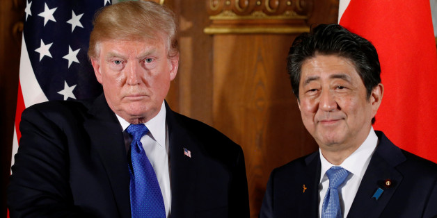 U.S. President Donald Trump and Japan's Prime Minister Shinzo Abe shake hands at the end of a news conference at Akasaka Palace in Tokyo, Japan, November 6, 2017. REUTERS/Jonathan Ernst