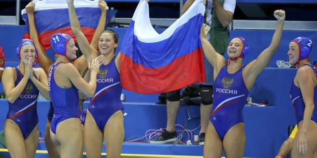 2016 Rio Olympics - Water Polo - Final - Women's Bronze Medal Match Hungary v Russia - Olympic Aquatics Stadium - Rio de Janeiro, Brazil - 19/08/2016. Russian players hold a Russian flag as they celebrate their win over Hungary. REUTERS/Laszlo Balogh FOR EDITORIAL USE ONLY. NOT FOR SALE FOR MARKETING OR ADVERTISING CAMPAIGNS.