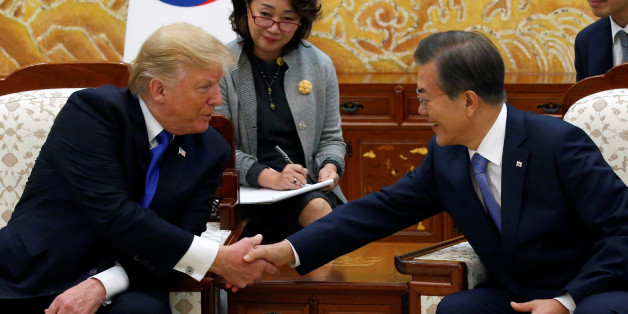 U.S. President Donald Trump and South Korea's President Moon Jae-in shake hands at South Korea's presidential Blue House in Seoul, South Korea, November 7, 2017. REUTERS/Jonathan Ernst