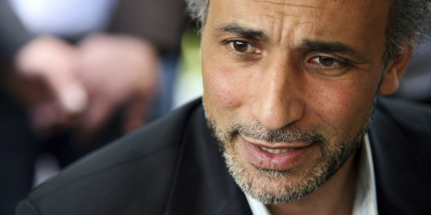 Author Tariq Ramadan talks with a journalist after a conference at the Er-Rahma mosque in Nantes, western France, April 25, 2010. Ramadan, a Swiss citizen of Egyptian origin who was born in Switzerland, has written extensively on Western Muslims and on Islam. He is president of the thinktank European Muslim Network in Brussels and teaches at Britain's Oxford University. REUTERS/Stephane Mahe (FRANCE - Tags: RELIGION PROFILE)