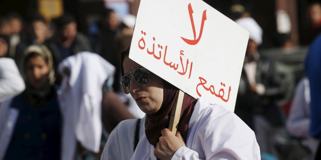 "A demonstrator holds a sign as she takes part in a demonstration in the city of Casablanca, on February 25, 2016. Teachers protest through the streets against the two new decrees reducing their stipends and job security during a demonstration organised by trainee teachers. The sign reads, ""Do not persecute teachers"". REUTERS/Youssef Boudlal"