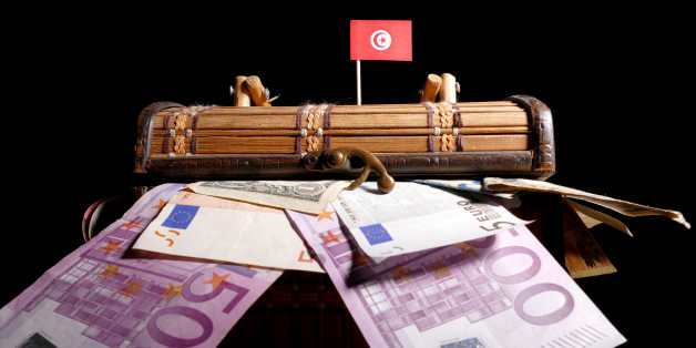 Tunisian flag on top of crate full of money