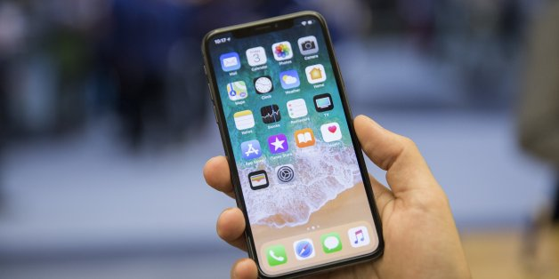 TORONTO, ON. November 3, 2017 - Creative Kelly McLaughlin shows off the iPhone X at the Apple store in the  Toronto Eaton Centre.        (Anne-Marie Jackson/Toronto Star via Getty Images)