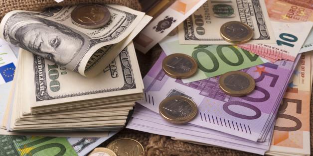 Paper money euro dollar banknotes coins sack