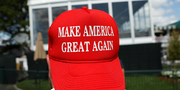 A supporter of U.S. President Donald Trump looks up toward Trump's personal enclosure during the U.S. Women's Open golf tournament at Trump National Golf Club in Bedminster, New Jersey, U.S. July 16, 2017.  REUTERS/Kevin Lamarque