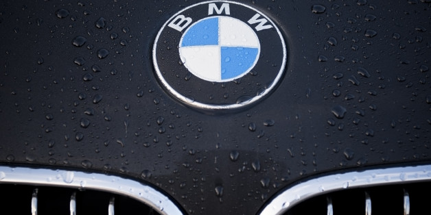 'Padua, Italy - July 6, 2011: Circle shape BMW logo and part of the front grill on a black car covered with dew drops. BMW (Bayerische Motoren Werke) is a German automobile, motorcycle and engine manufacturing company founded in 1916.'