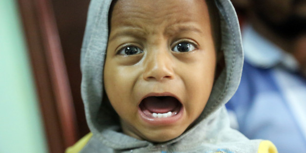 A Yemeni child, who is suspected of being infected with cholera, cries at a hospital in the Yemeni coastal city of Hodeidah on November 5, 2017.Humanitarian responders have this year provided direct aid to more than seven million Yemenis living on the brink of famine, according to the UN Office for the Coordination of Humanitarian Affairs. / AFP PHOTO / ABDO HYDER        (Photo credit should read ABDO HYDER/AFP/Getty Images)
