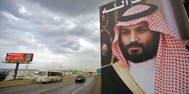 A poster of Lebanese Prime Minister Saad Hariri, who resigned last week in a televised speech, hangs on the side of a road with a phrase reading in Arabic, ' God protect you' in the northern Lebanese port city of Tripoli on November 9, 2017.Lebanon's former prime minister Saad Hariri announced his resignation last weekend from the Saudi capital Riyadh in a televised speech which sparked concerns of a political crisis in Lebanon as tensions between Saudi Arabia and Iran escalated. / AFP PHOTO / I