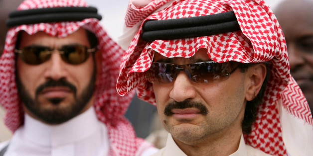 Saudi Prince Al-Walid bin Talal talks to reporters at a food distribution point in Shaba, 10 km from the northeast town of Garrisa, Kenya June 6, 2006. REUTERS/Stephen Morrison/Pool (KENYA)