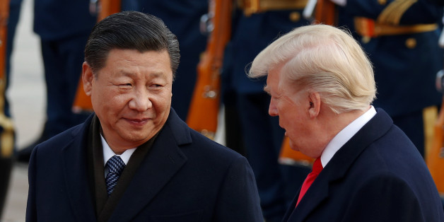 U.S. President Donald Trump takes part in a welcoming ceremony with China's President Xi Jinping at the Great Hall of the People in Beijing, China, November 9, 2017. REUTERS/Damir Sagolj
