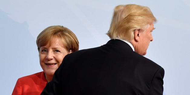 German Chancellor Angela Merkel greets U.S. President Donald Trump at the beginning of the G20 summit in Hamburg, Germany, July 7, 2017. REUTERS/John MACDOUGALL,POOL