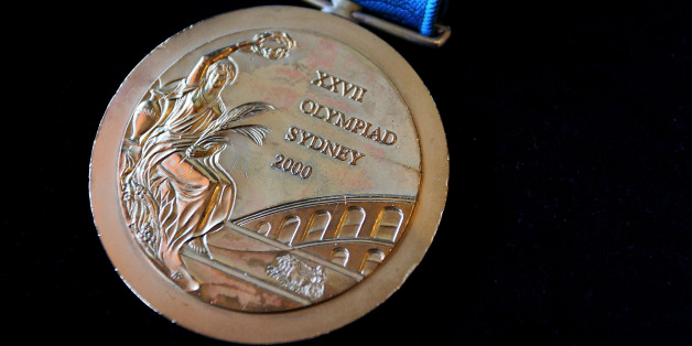 SYDNEY, AUSTRALIA - NOVEMBER 09:  The 2000 Olympic Gold Medal won by Michael Diamond as seen at Lawsons Auctioneers on November 9, 2017 in Sydney, Australia. Michael Diamond competed in six Olympic Games and is a dual Olympic gold medalist, who won the men's trap shooting at the Atlanta 1996 and Sydney 2000 Olympic Games. He is selling his Sydney Olympic medal to pay off debts after being acquitted following an 18-month legal battle over drink-driving and firearms charges.  (Photo by Lisa Maree