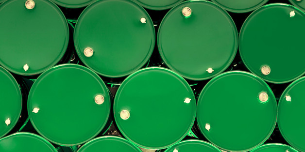 green steel chemical tanks or oil tanks stacked in a row. background and texture