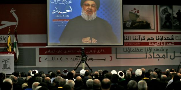 A picture taken on November 10, 2017, shows Hassan Nasrallah, the head of Lebanon's militant Shiite movement Hezbollah, giving a televised address during a gathering in Beirut's southern suburb.Nasrallah said Saad Hariri, who resigned as Lebanese prime minister from Riyadh last week, was 'detained' by Saudi Arabia. / AFP PHOTO / ANWAR AMRO        (Photo credit should read ANWAR AMRO/AFP/Getty Images)