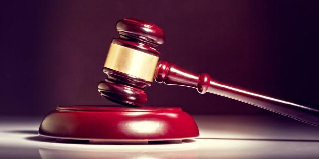 wooden judge gavel on white background