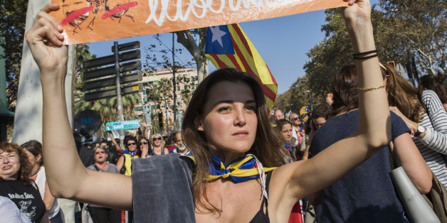 Thousands of Catalan independence supporters  have marched in center city  and massed outside the Parliament of Catalonia waiting for the votes to declare independence from Spain in Barcelona,  Spain, on 27 October 2017. (Photo by Mauro Ujetto/NurPhoto via Getty Images)