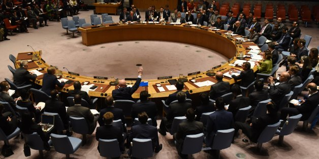 The UN Security Council votes to  extend investigations into who is responsible for chemical weapons attacks in Syria at the United Nations on October 24, 2017. Russian Ambassador to the UN Vassily Nebenzia voted no to the resolution. / AFP PHOTO / TIMOTHY A. CLARY        (Photo credit should read TIMOTHY A. CLARY/AFP/Getty Images)
