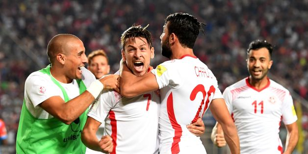 Tunisia's forward Ghaylene Chaalali (2nd R) celebrates with Youssef Msakni (2nd L) and other teammates after scoring a goal during the World Cup 2018 qualifying football match between Tunisia and Congo on September 1, 2017 at the Rades Olympic Stadium in Tunis. / AFP PHOTO / FETHI BELAID        (Photo credit should read FETHI BELAID/AFP/Getty Images)