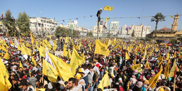 Fatah supporters wave the party flag as they take part in a rally in Gaza City on November 11, 2017. marking the death anniversary of late Palestinian leader Yasser Arafat.The anniversary event was billed as a show of national unity after the Islamists of Hamas struck a reconciliation agreement last month with the rival Fatah movement founded and led by Arafat until his death in 2004. / AFP PHOTO / MAHMUD HAMS        (Photo credit should read MAHMUD HAMS/AFP/Getty Images)