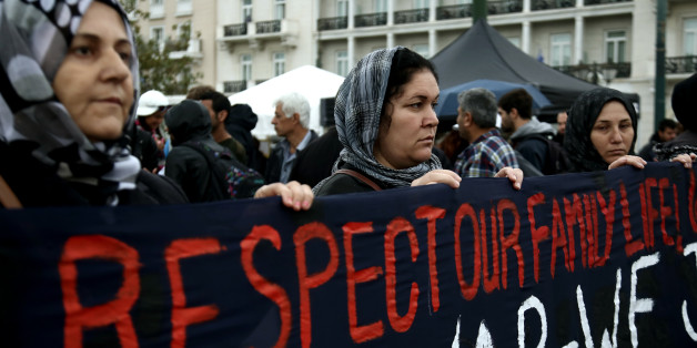 Syrian women protest at Syntagma square in central Athens, Greece. Families of Syrians refugees marched to the German embassy in Athens, on November 8, 2017, demanding the right to reunificate with their families in Germany. Refugees are on hunger strike the last 8 days having camped in Constitution Square, central Athens, opposite the Parliament. (Photo by Panayotis Tzamaros/NurPhoto via Getty Images)