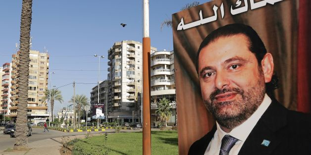A poster of Lebanese Prime Minister Saad Hariri, who resigned last week in a televised speech airing from the Saudi capital Riyadh, hangs on the side of a roundabout in the northern Lebanese port city of Tripoli on November 10, 2017, with a caption above reading in Arabic: 'God protect you.'Hariri's announced resignation sparked concerns of a political crisis in Lebanon as tensions between Saudi Arabia and Iran escalated. / AFP PHOTO / JOSEPH EID        (Photo credit should read JOSEPH EID/AFP/G