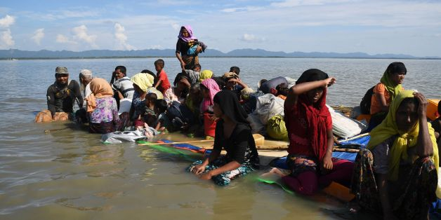 Rohingya Muslim refugees sail a makeshift raft made from jerrycans and bamboo across the Naf River into Bangladesh at Sabrang, Teknaf district on November 11, 2017.More than 600,000 Rohingya have fled to Bangladesh since late August carrying accounts of murder, rape and arson at the hands of Myanmar's powerful army during a military crackdown dubbed as 'ethnic cleansing' by the UN. / AFP PHOTO / Dibyangshu SARKAR        (Photo credit should read DIBYANGSHU SARKAR/AFP/Getty Images)