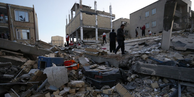 People including rescue personnel conduct search and rescue work following a 7.3-magnitude earthquake at Sarpol-e Zahab in Iran's Kermanshah province on November 13, 2017.
