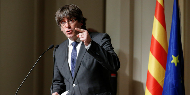 Former Catalan leader Carles Puigdemont gestures while delivering a speech to Catalan mayors in Brussels, Belgium, November 7, 2017.  REUTERS/Pascal Rossignol