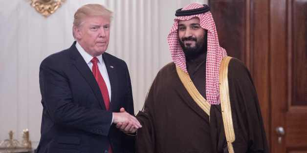 US President Donald Trump and Saudi Deputy Crown Prince and Defense Minister Mohammed bin Salman shake hands in the State Dining Room before lunch at the White House in Washington, DC, on March 14, 2017.Trump welcomed the prince to the Oval Office, as both countries expect to improve ties that were frequently strained under Barack Obama's administration. Saudi Arabia is likely to welcome Trump's harder line on its arch-rival Iran and there is likely to be less friction over Riyadh's war against