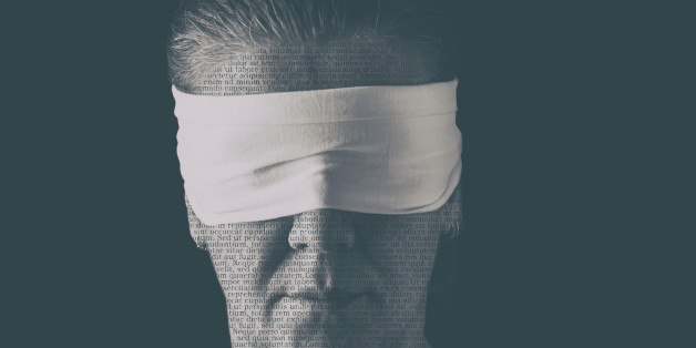 Blindfolded woman close up patterned with no-sense words. Concept of censorship, freedom of speech, freedom of press.