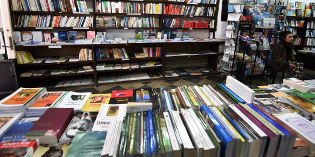 Books are exposed on shelves at the Ijtihed bookshop in the Algerian capital Algiers on February 16, 2015.  AFP PHOTO / FAROUK BATICHE        (Photo credit should read FAROUK BATICHE/AFP/Getty Images)