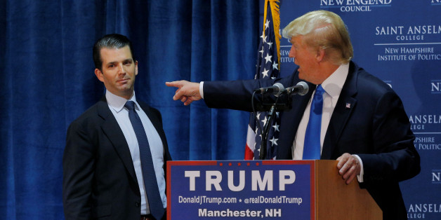 """FILE PHOTO: Then U.S. Republican presidential candidate Donald Trump (R) welcomes his son Donald Trump Jr. to the stage at one of the New England Council's """"Politics and Eggs' breakfasts in Manchester, New Hampshire November 11, 2015.  REUTERS/Brian Snyder/Files"""